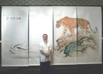 Andy Chan in front of his work